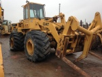 936E wheel loader with logging forks plus a bucket